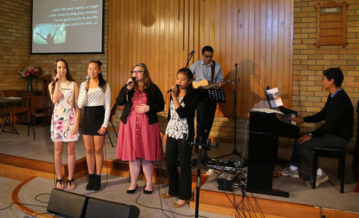 Teens taking song service